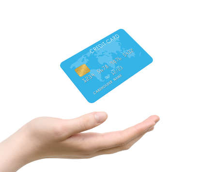 Female hand and bank credit card levitating over it isolated on white background 写真素材