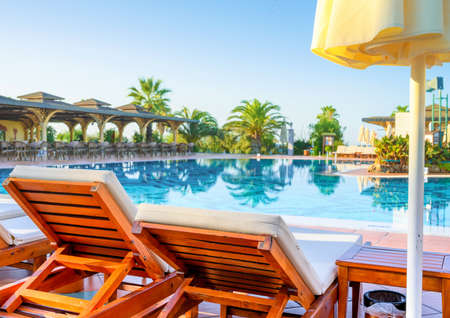 Empty sunbeds and swimming pool in luxury resort