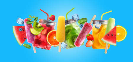 Bright Summer cocktail drinks and fruits on blue background.