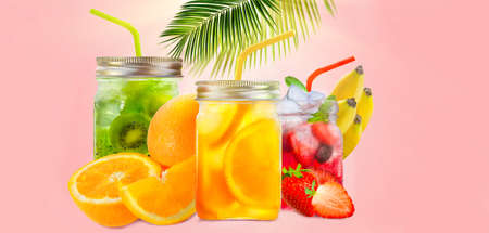 Fresh jars of juice with fruit mix on pink background with palm leaf. Concept of healthy summer cocktails, drinks, lemonade with copy space