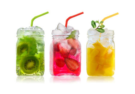 Bright Colorful refreshing summer drinks in glass jars and straws isolated on a white background
