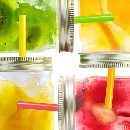 Concept collage of healthy summer cocktails, drinks, lemonade of fresh fruit mix in glass jars with straws