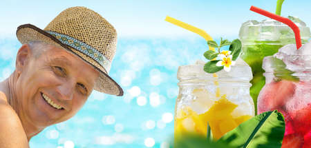 A man is enjoying his vacation relaxing with refreshing drinks on the sea beach on blue turquoise sea background.