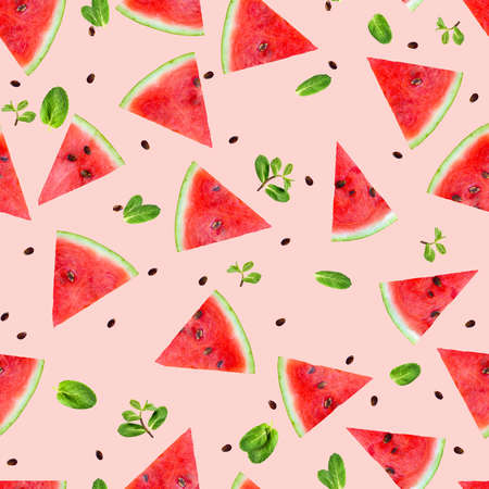 Pattern of watermelon slices with fresh mint leaves.