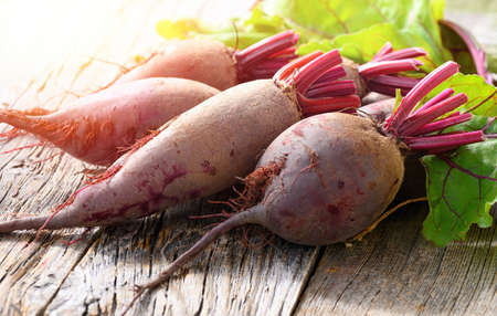 Red Beets on wooden rustic background. Organic Beetroot.