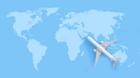 Traveling concept , white aircraft model on world map