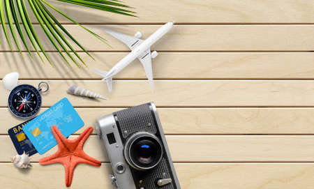 Summer vacation background with traveler accessories, airplane model and seashells. Top view