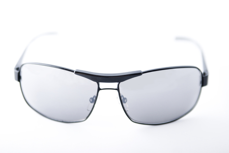 4869f3a45 Black-rimmed sunglasses on white background. Stock Photo