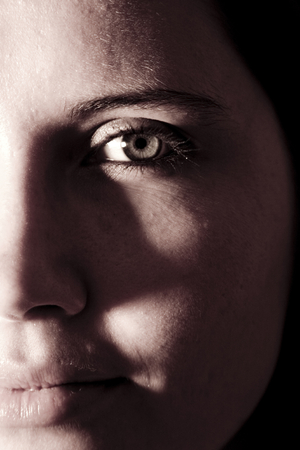 preoccupied: Young woman half face; light study; portrait.