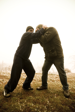opponent: A man preparing to kick his opponent with his knee. Stock Photo
