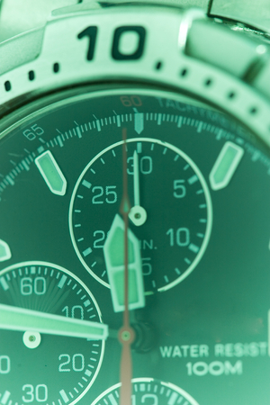 seconds: Macro detail of a swiss made watch, showing seconds timer in motion; time passing by. Stock Photo