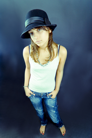 teen aged: Teen aged model wearing blue jeans and a white t-shirt