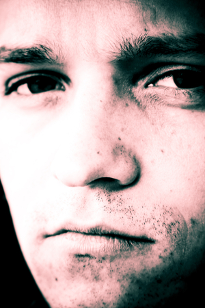 countenance: Portrait of man with sad expression.