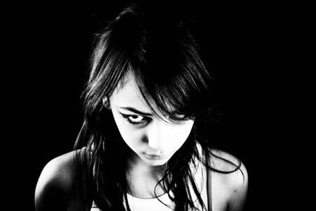 heavily: Heavily made-up teen girl looks angry Stock Photo