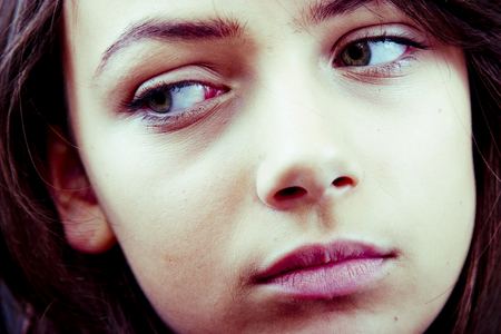 hesitant: Closeup portrait of a distracted teenage girl, averting her eyes. Horizontal format. Stock Photo