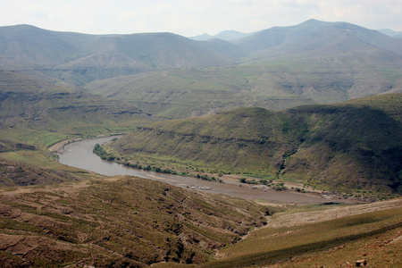 River bend of the Oranje River near the village of Makunyapane, Lesotho Stock Photo