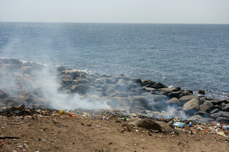 Waste disposal on Ile de Goree Island, Dakar, Senegal Stock Photo