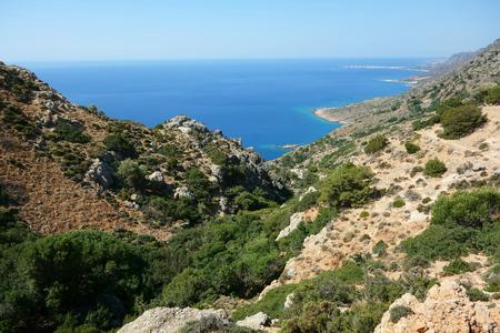 Coastline between Paleochoras and Lisos, E4 European long distance hiking path, Crete, Greece Фото со стока