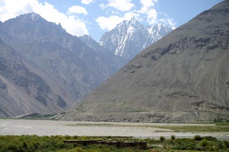 Afghan Wakhan valley as seen from the Tajik border, Pamir Mountain Range, Tajikistan Stock Photo