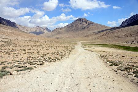 Long distance cycling in the Wakhan valley, Pamir Mountain Range, Tajikistan