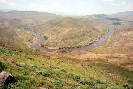 River bend of the Oranje River near the village of Makunyapane, Lesotho Stock Photo
