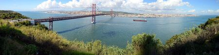 The 25 April bridge (Ponte 25 de Abril) is a steel suspension bridge crossing the Targus river, Lisbon, Portugal Banco de Imagens