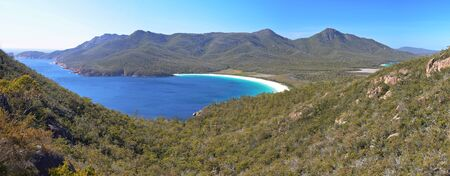View over turquoise waters of Wineglass Bay, Freycinet National Park, Tasmania, Australia