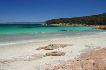 View over turquoise waters of Hazard Beach (next to Wineglass Bay), Freycinet National Park, Tasmania, Australia