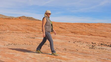 Tourist Hiking In Desert Woman Walking On The Park Red Rock