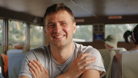 Portrait Handsome Caucasian Man Smiling Looking At Camera Sitting In Transport Stok Fotoğraf