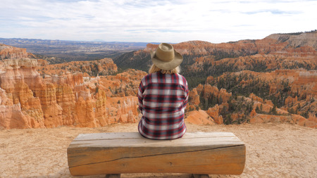 Woman Sitting On A Bench Looking And Enjoying View And Landscapes Bryce Canyon Stok Fotoğraf