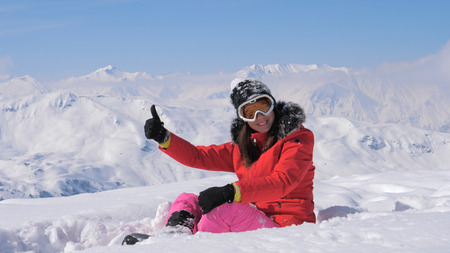 Woman Skier Shows Hand Ok And Finger Up On The Snowy Mountains Background Stok Fotoğraf