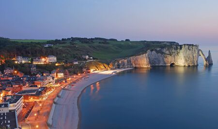 the famous Village of Etretat in Normandy,France photo