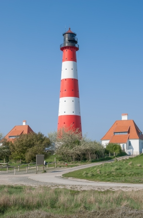 german north sea region: the famous Lighthouse of Westerheversand at North Sea,Germany