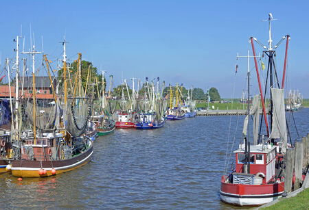 Crab Fishing Boats in Harbor of Greetsiel,east Frisia,North Sea,Germany photo