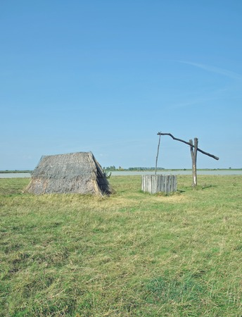 draw well: Reed Hut and Draw Well at Seewinkel,Lake Neusiedler See,Burgenland,Austria Stock Photo