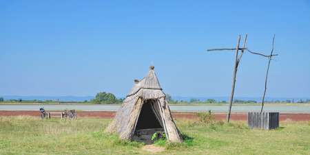 draw well: traditional Reed Hut and Draw Well in Seewinkel region at Lake Neusiedl,Burgenland,Austria