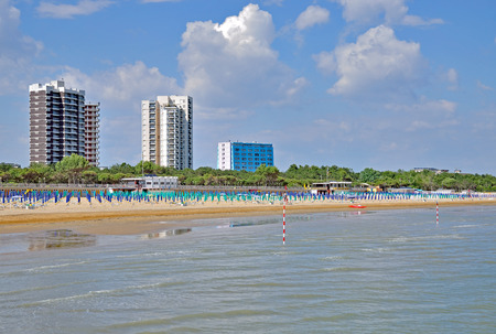 Beach and Village of Lignano Sabbiadoro at adriatic Sea,Veneto,Italy Standard-Bild