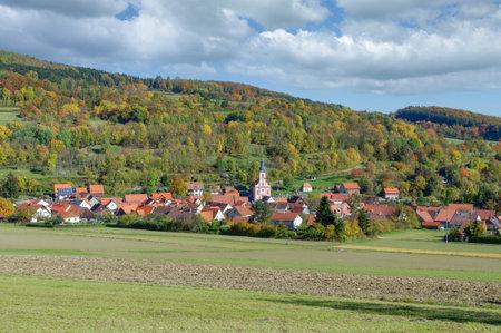 idyllic Village in Autumn Landscape,Rhoen,Germany Standard-Bild