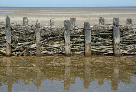 Coast Protection in North Frisia at North Sea called Lahnung,Schleswig-Holstein,Germany Standard-Bild