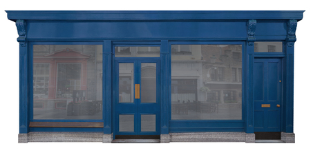 Blue painted wooden facade of a sales room with shop and extra house entrance isolated on white background