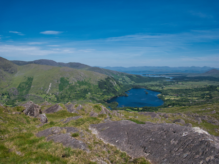 A view from Healy Pass on the lake and the landscape in Ireland in sunshine