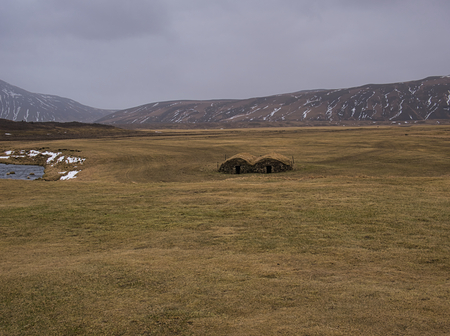 Two detached peat houses in a meadow in Iceland Reklamní fotografie