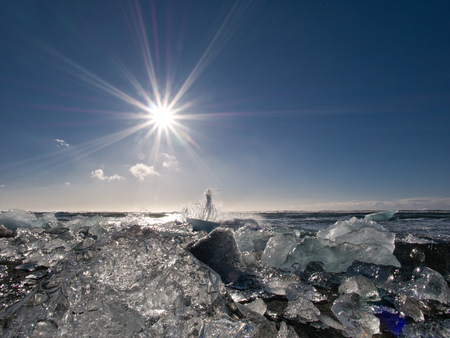 The glacier ice on the coast of the Diamond Beach with low sun