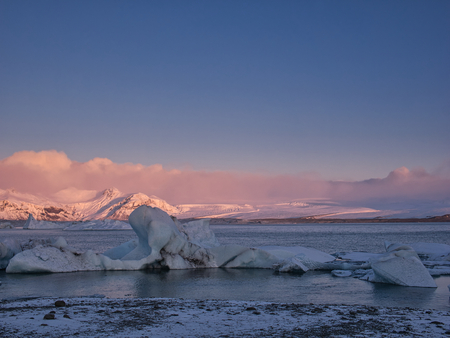 A sunrise at the glacier lagoon in Iceland with ice floes