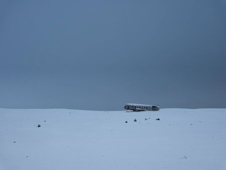 Crashed plane on a snow-covered meadow in Iceland
