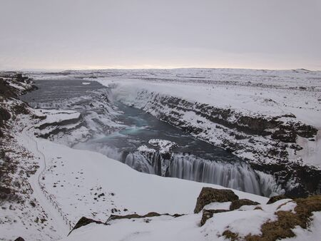 The snowy path to Gullfoss Waterfall in the south of Iceland Standard-Bild - 140649133