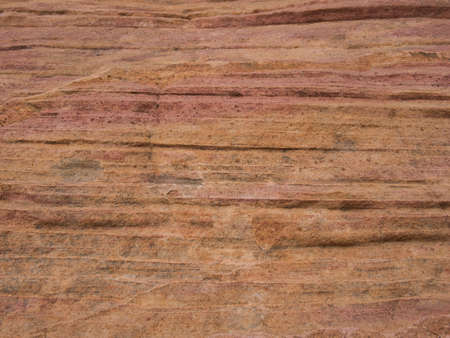 A rock face with colourful lines and sandy but very hard surface 写真素材