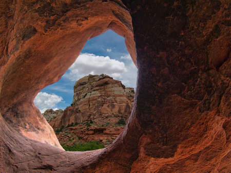 The view through a small rock hole to a big rocky mountain 写真素材