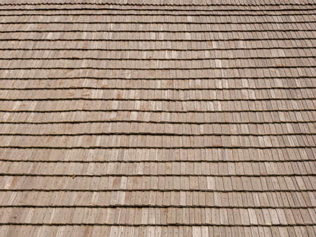 Wood shingles fixed with wooden nails on an old wooden roof Stock Photo